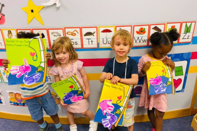 kids showing their works