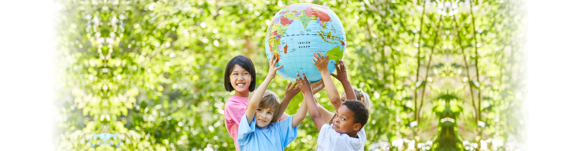 children group as a team holds a globe