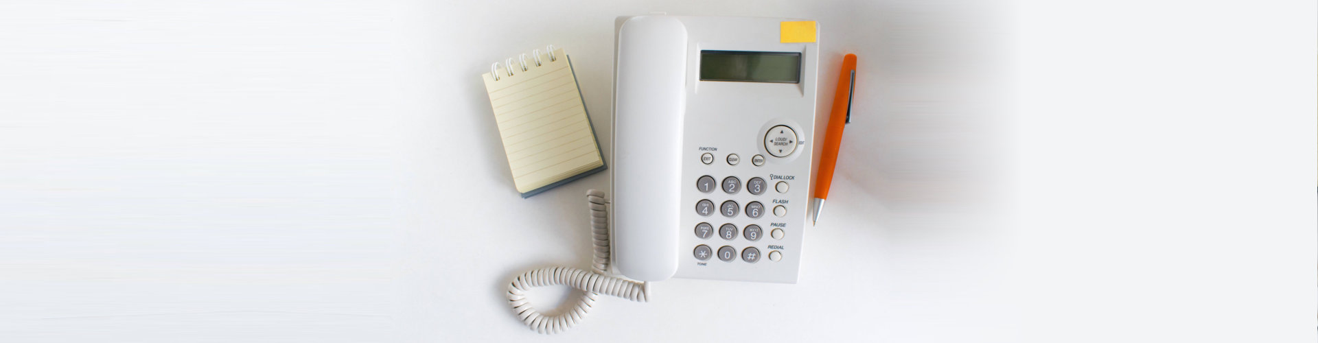 notepad, telephone, and pen