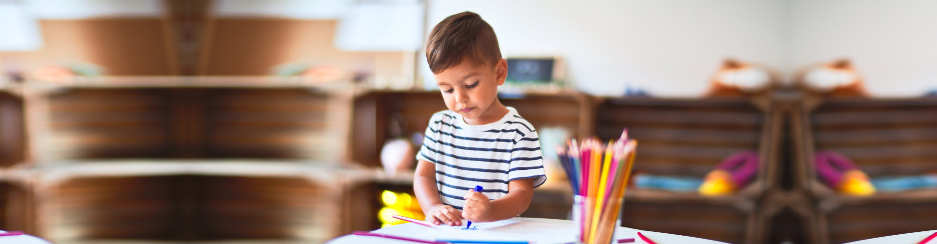 child drawing on the desk