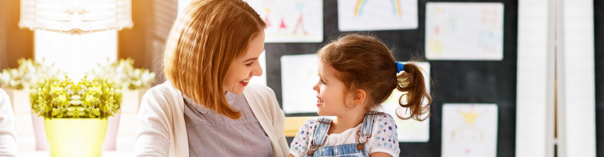 teacher and little girl student